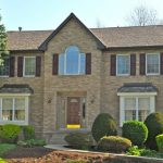 Brick House with Shutters | Pittsburgh roofing contractors