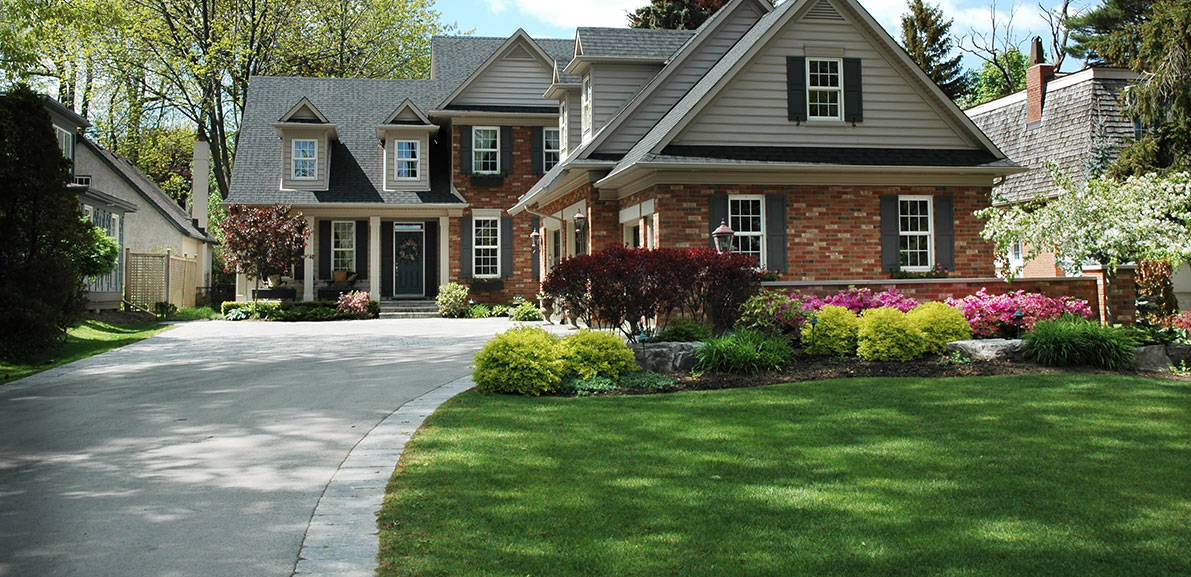 Brick House with Shrubs | RoofingContractorPittsburgh.com