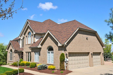 Side View of Large Brick House | RoofingContractorPittsburgh.com