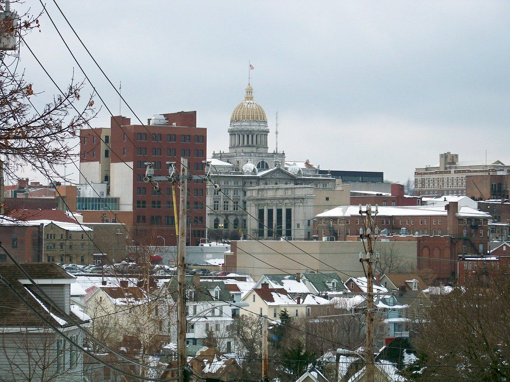 Greensburg, PA Skyline with power lines and city hall with dome in the distance
