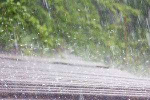 Hail hitting asphalt shingle roof