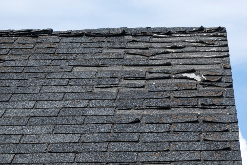 Old Roof with failing shinge system