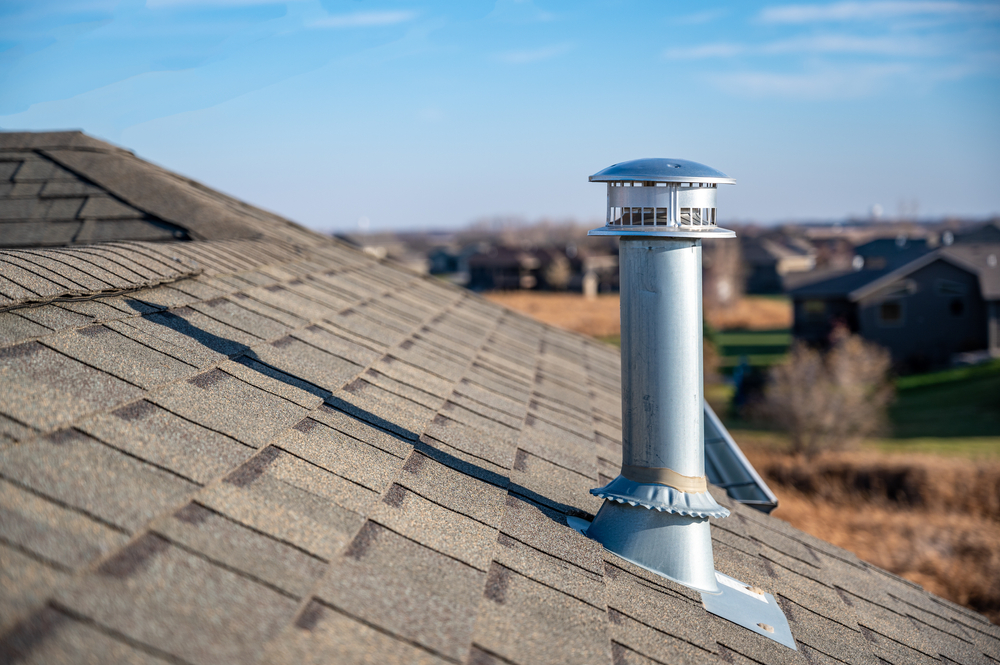 Side,View,Of,A,Galvanized,Metal,Chimney,Exhaust,On,Asphalt | RoofingContractorPittsburgh.com